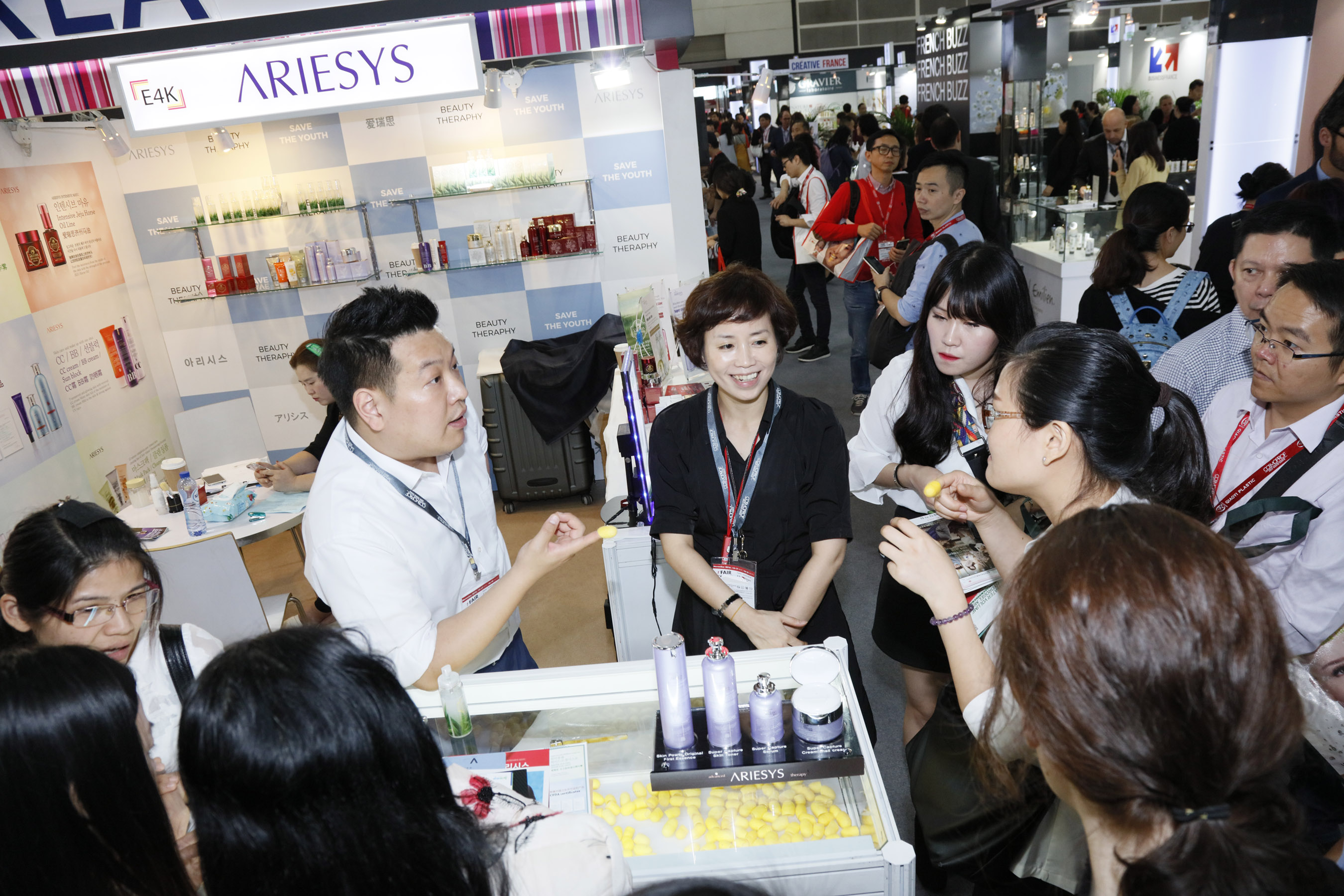 An exhibitor is introducing new products to visitors in Cosmoprof Asia